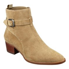 A low heel casual bootie with almond toe shape and buckle and strap detail.