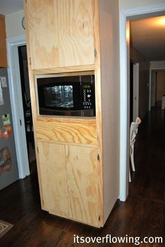 Kitchen: Building Simple Drawers, custom microwave cabinet, with hidden trash can.