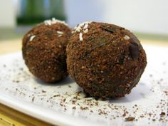 Raw Chocolate Cocount Balls....I have made something like these and they remind me of lara bars