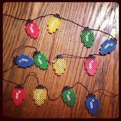 Christmas light guirnalde perler beads by redtheredhead bit Christmas ornaments} Perler Bead Designs, Hama Beads Design, Perler Bead Art, Melty Bead Patterns, Pearler Bead Patterns, Perler Patterns, Beading Patterns, Christmas Perler Beads, Art Perle