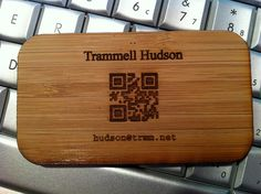 Bamboo QR code    Laser cut bamboo QR codes are indeed scannable. Be sure to generate with Q or H encoding level to ensure there are plenty of extra bits.    Also, note that if the text contains only UPPERCASE letters then an alternate encoding can be used to reduce the size of the QR code. And remember that host names and protocol descriptors are not case sensitive.