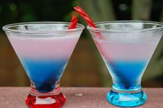1 oz frozen pink pink lemonade concentrate (I like minute maid the best) 1 1/2 oz water 2 oz plain vodka 1/2 oz blue Curacao Shake the lemonade, water, and vodka together in a martini shaker and strain into a glass. Carefully pour the blue Curacao down the side and it will settle on the bottom. Garnish with a red twizzler or fresh strawberries if desired. Enjoy.