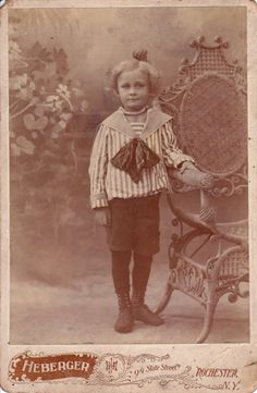 Vintage cabinet card of cute boy with curly hair