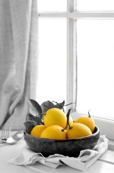 The yellow lemons brighten up the setting while maintaining its peace and calmness.