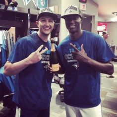 Traded together in July from Colorado to Toronto, Troy Tulowitzki & LaTroy Hawkins now celebrate in October as the Toronto Blue Jays' head into the playoffs for the first time in 22 years.