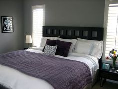 like the purple throw with the gray walls only I would go with a lighter gray