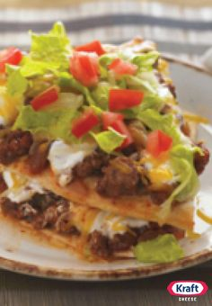 """Layered Enchilada Bake — This recipe has all the savory flavors of enchiladas—without all the rolling. The whole family will want to customize their toppings for a delicious spin on homemade """"takeout."""""""