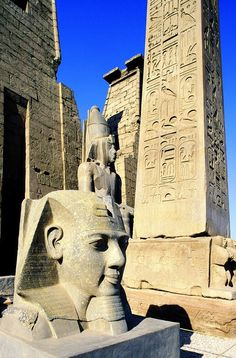 Head of Ramses II at the entrance Pylons of Luxor Temple. Ramses added these Pylons and behind them a courtyard on the front of the existing temple, built by Amenhotep III, Luxor, Egypt Ancient Egyptian Art, Ancient Ruins, Ancient History, Egyptian Things, Kemet Egypt, Luxor Egypt, Foto Picture, Luxor Temple, Culture Art