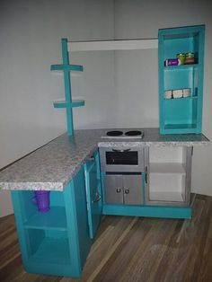 What an amazing addition to your doll house! This gourmet kitchen is constructed from heavy duty foam board. Its a very sturdy unit that can withstand all the love your child can give it! This item is made to order. At the time of order, please leave a note stating your color