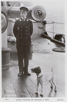 HRH Edward Prince of Wales, and a terrier on board HMS 'Hindustan'. 1911. National Maritime Museum.