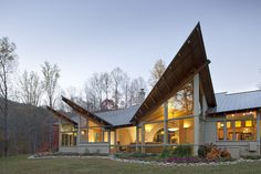 The site for this net-zero, passive and active solar home is a nearly level clearing at the top of a gentle knoll with views of Mount Pisgah to the south. 'Pop-up' roofs lift up to...