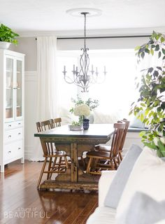 Spring Home Tour | Our Dining Room - A modern farmhouse feels bright and inviting as it embraces the spring season. Tour the full home at http://www.aburstofbeautiful.com.