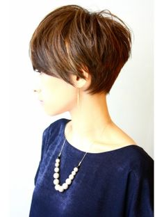 Short haircut but high nape line makes short tight look in the back.