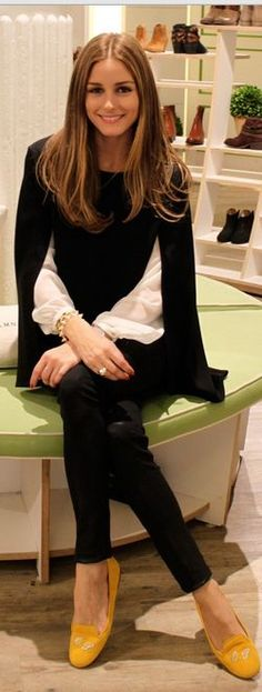Who made  Olivia Palermos black cape sweater, white top, yellow shoes and black leather pants?