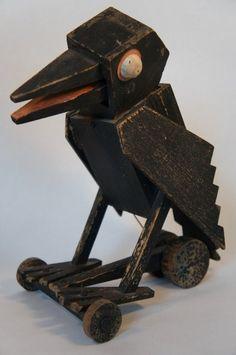 Early 20th century folk art crow pull toy.
