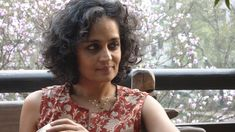 """Arundhati Roy, an award-winning Indian writer and renowned global justice activist, has been interviewed on Democracy Now! many times, discussing environmental issues, Indian politics and her books and essays. She has written many books, including, """"Capitalism: A Ghost Story,"""" """"The God of Small Things,"""" """"An Ordinary Person's Guide to Empire"""" and """"Field Notes on Democracy: Listening to Grasshoppers."""""""