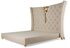 Christopher Guy :: 20-0540 -- Bois de Vincennes A spectacular headboard featuring Christopher's signature hand-carved camelia, perfectly complemented by the sumptuous buttoned upholstery and encased within gently curving borders. The complemented bed base is 20-0541.