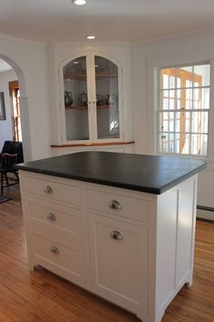 white shaker style cabinets, island and soapstone counters