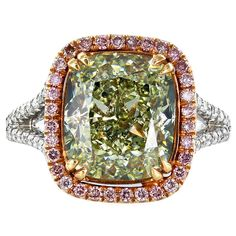 5.58 Carat GIA Cert Yellow-Green Diamond Gold Solitaire Ring | From a unique collection of vintage solitaire rings at https://www.1stdibs.com/jewelry/rings/solitaire-rings/