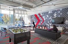design blitz finishes comcast office in red – Office lounge Corporate Design, Corporate Interiors, Workplace Design, Office Interiors, Retail Design, Commercial Design, Commercial Interiors, Office Games, Innovation Centre