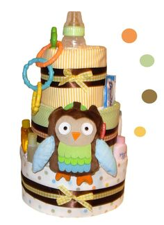 Lovingly adorned with a plush Baby Owl stroller toy, and decorated with bright and colorful accents, this diaper cake comes in a 3-tier size and can be color-customized for a Boy, a Girl, or a Neutral (don't know yet) finish. This non-edible cake is crafted out of brand name
