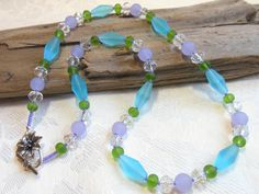 Seaglass necklace, beach necklace, aqua, lavender and green seaglass, clear crystals, flower white bronze toggle by #EyeCandybyCathy on Etsy