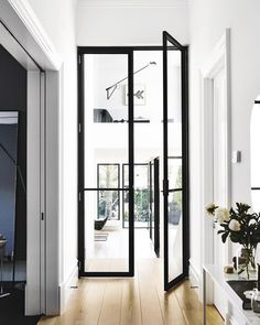 THIS THOUGH via @mydomaine.au ✔️Happy Monday lovely hearts. Team DS. X #designstuff #hallway #entry #entryway #interior #interiors #interiordesign #interiorarchitecture #interiorinspiration #steelframedoors #upstairs #downstairs #doubleheight #architecture #archilovers #black #white #whiteinterior #doorway #door