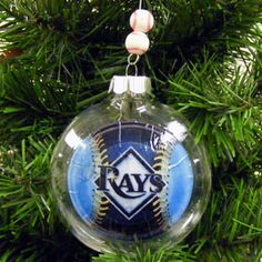 Any sports fan will love this Go Team! ornament. We found our team logo online, printed it on an inkjet printer, and applied with our old favorite, Mod Podge. This is made with a shatterproof PET plastic ornament.