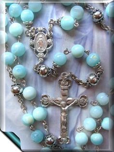 Silver and blue rosary. Very similar to the one Mom has.