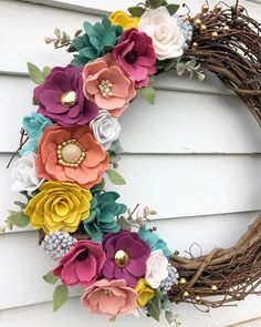 "Do you have a flower lover on your list? This 18"" all seasons wreath is the perfect gift for someone who loves a pop of color and texture in their home throughout the year. Available tonight at 4 PST! . . . #elleandlu #feltflorist #feltflowers #feltwreath"