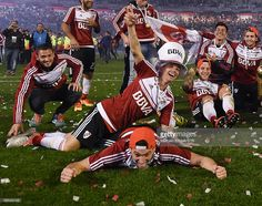 Andres D'Alessandro, Lucas Alario and teammates of River Plate celebrate with the trophy after winning the Recopa Sudamericana 2016 during a second leg match between River Plate and Independiente Santa Fe as part of Recopa Sudamericana 2016 at Monumental Stadium on August 25, 2016 in Buenos Aires, Argentina.