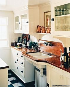 wood counter top....would like a look similar to this in our bathroom. Would wood countertops be a pain in the long run??