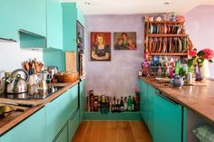 """When she bought this flat seven years ago, it had bachelor pad vibes. """"All the kitchen cabinet doors were in black shiny plastic."""""""