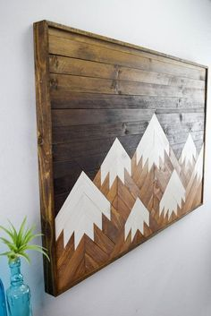 Coulee Cottage mountain art above bed of Waterton in neutral wood/grey colors?