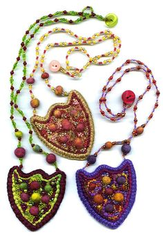 https://flic.kr/p/3JDr4N | Emblem Purses | Embroidered, beaded and decorated necklaces with inner pocket.  Embellished with felted balls, French knots, various beads and couched threads.  Button clasp.  www.chursinoff.com/kirsten/