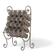 We love this Flower Bucket Stand for use in your potting shed or home office. Bring the charm of a French Flower Market to your home. From Indeed Decor.
