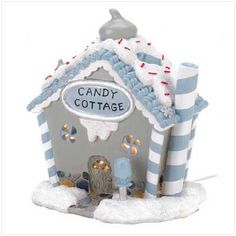 "Snowbuddies Candy Cottage  Decked out with fluffy white frosting and scrumptious sweet treats, this snuggly light-up storybook shack is the perfect addition to any fanciful winter scene!  Weight 2.2 lbs. UL Recognized 6"" x 4 3/4"" x 6 1/2"" high. Resin.   Light bulb included."