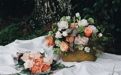 Basket with flowers, roses, peonies, beautiful bouquets, orange roses