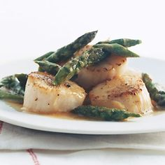 Sautéing scallops and asparagus adds depth to their subtle flavors — and the dish only gets better with the addition of a silky beurre blanc–style sauce.