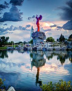 Keeper of the Plains, Sunset, Wichita, Kansas.  The Keeper of the Plains in Wichita, Kansas was created in 1974 and placed at the confluence of the Arkansas and Little Arkansas Rivers. The 44', 5 ton stylized sculpture of an Indian Chief was designed by Native American artist Blackbear Bosin.  I met Mr. Bosin when I worked at Acme Lithographers in Wichita, Kansas.