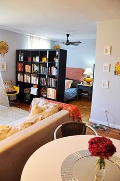 black bookcase separate bedroom and living room