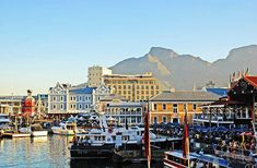 """CAPE TOWN South Africa's """"Mother City"""" spreads magnificently around Table Mountain. Its popular Victoria & Albert Waterfront is a vibrant setting for many of the city's top hotels and restaurants. Africa Destinations, Travel Destinations, Travel Tips, Travel Hacks, Places Around The World, Around The Worlds, Cape Town South Africa, Paradise On Earth, Top Hotels"""