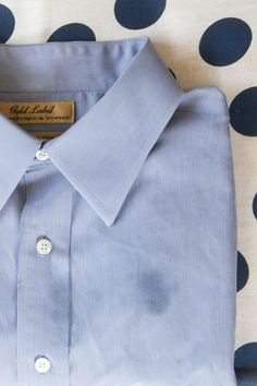 How To Remove Grease Stains-rub dish detergent into the stain and let it sit for a few minutes, then wash