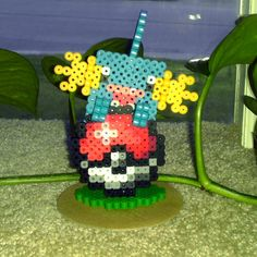 Perler Pokeball Stand Pokemon Sprites, Bead Art, Submissive, Christmas Ornaments, Beads, Trending Outfits, Holiday Decor, Unique Jewelry, Handmade Gifts