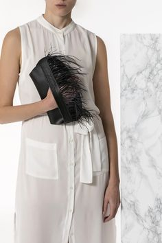 Bring a glamorous edge to your evening look with the Domna design clutch. Handmade of fine quality calf leather and silky feathers, it comes in 3 colors, black, camel (waxed tan) and nude (nubuck). Greek Chic Handmades bags for Women are designed and handcrafted in Athens, Greece from the same premium leather we built the sandals with and the impeccable local craftsmanship. Find your fav! Black Clutch Bags, Leather Clutch Bags, Black Leather, Black Camel, Calf Leather, Evening Outfits, Leather Bags Handmade, Lace Up Sandals, Bohemian Style