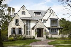 Breathtaking windows to the left of front porch - fantastic design