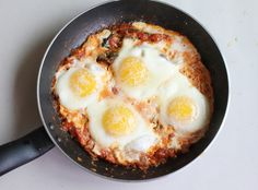 Spanish Eggs [[MORE]] Ingredients4 eggs1/2 a can of diced tomatoes 1/4 medium onion, finely chopped. 1 clove of garlic, finely chopped2 stal...