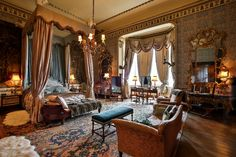 Belvoir Castle - Tapestry Room was used a he new Queen's bedroom in the film Young Victorian, and the four-poster bed was made for the set. 'VR' is embroidered on the headboard.