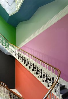 Striking & playful color concept for walls & ceiling of a main stairwell by © Gloria Zein. Photography © Richard Bryant.