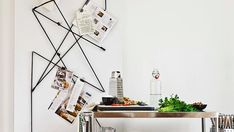 Tired of traditional diamond pinboards?  Try this modern art take on it made with eyelets, bungee cord, and bulldog clips.